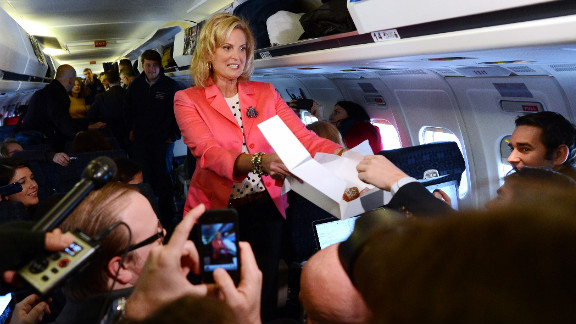 Ann Romney offers pastries to journalists aboard GOP presidential candidate Mitt Romney