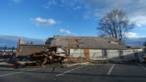 A house sits devastated by Superstorm Sandy on Friday, November 2, in Union Beach, New Jersey. The cost of the storm
