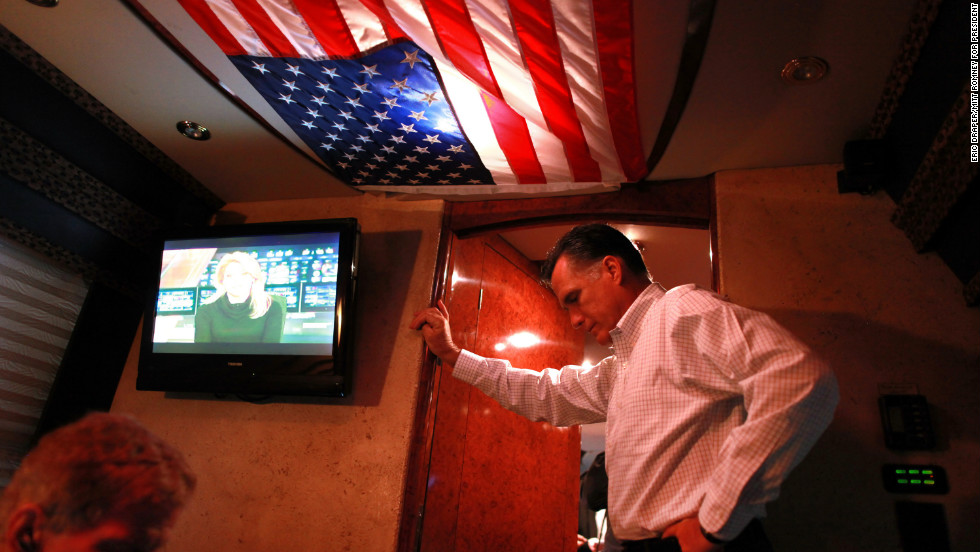 Romney pauses aboard his campaign bus in Mansfield, Ohio, on Oct. 28, 2012.