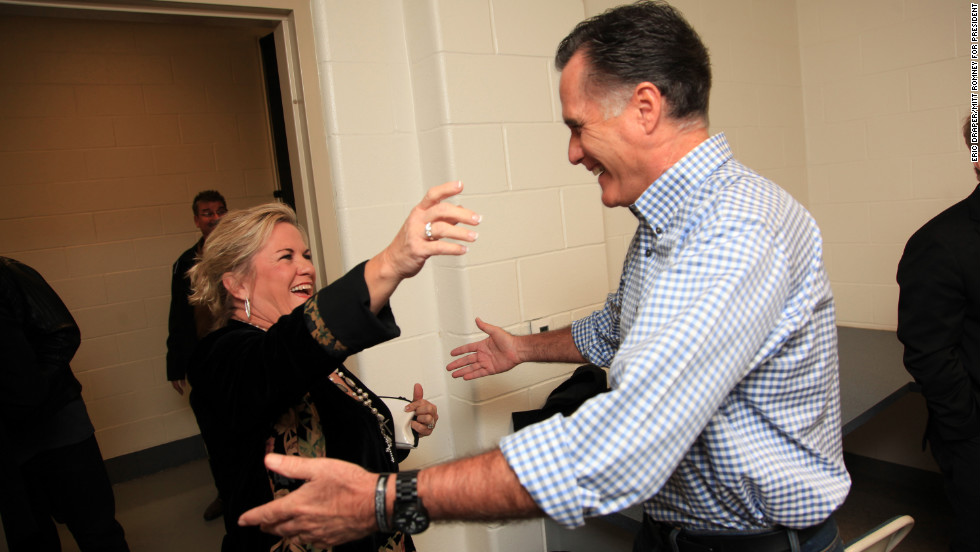 Romney hugs Kelly Owen, wife of singer Randy Owen of Alabama, backstage before a hurricane relief event in Kettering, Ohio, on Oct. 30, 2012.