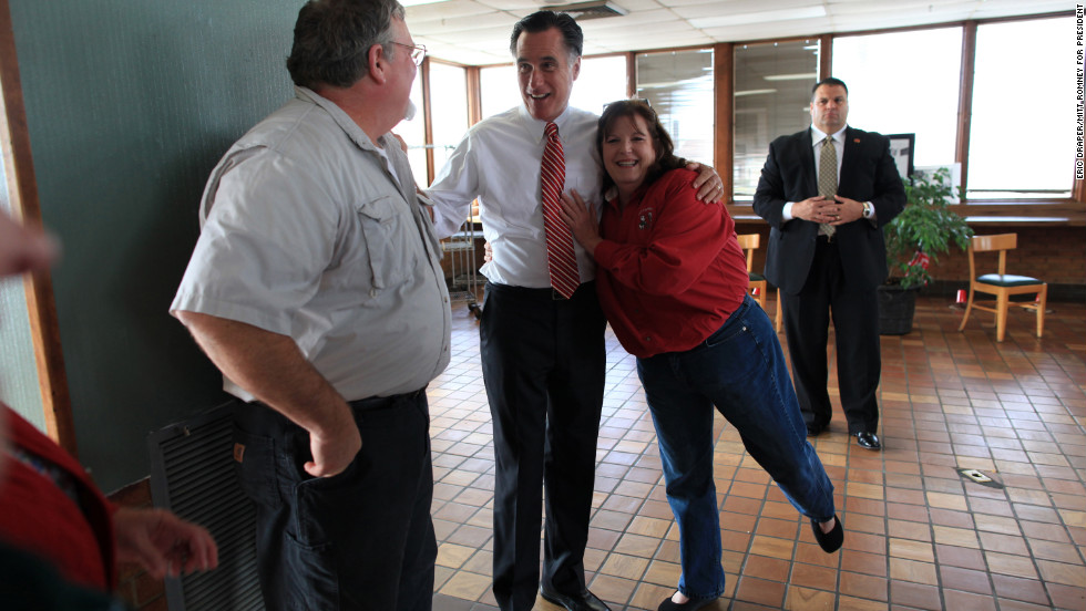 Romney is hugged by restaurant owner Rhoda Elliott during a visit to her struggling business in Richmond, Virginia, on Nov. 1, 2012.