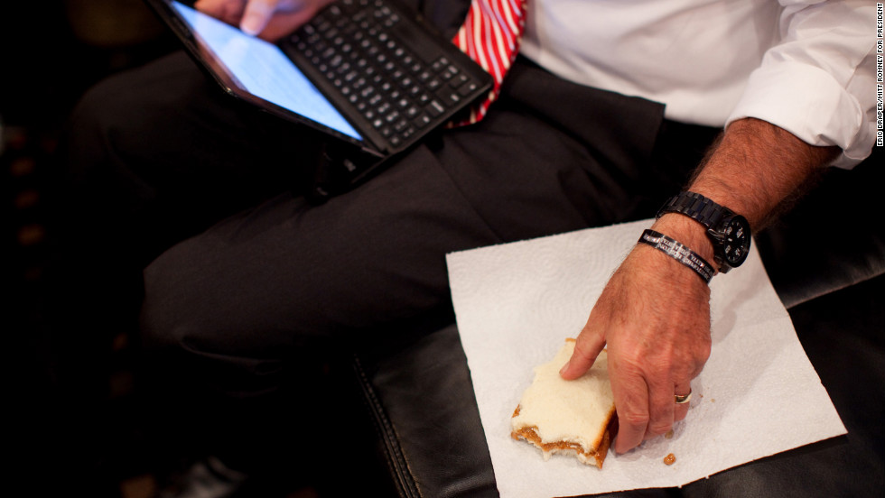 Romney eats a peanut butter and jelly sandwich while working on a speech aboard his campaign bus in Doswell, Virginia, on Nov. 1, 2012.