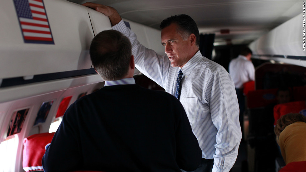 Romney talks with senior advisor Bob White aboard his campaign plane during a flight from New Hampshire to Wisconsin, Nov. 3, 2012.