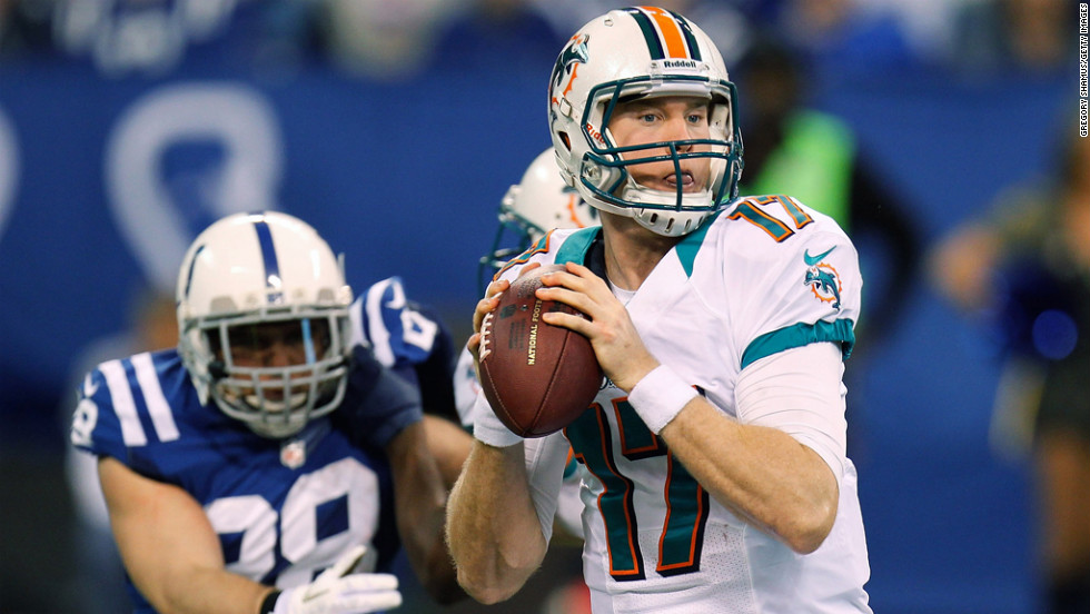 Ryan Tannehill of the Dolphins gets ready to throw a first quarter pass while being rushed by Tom Zbikowski of the Colts on Sunday.