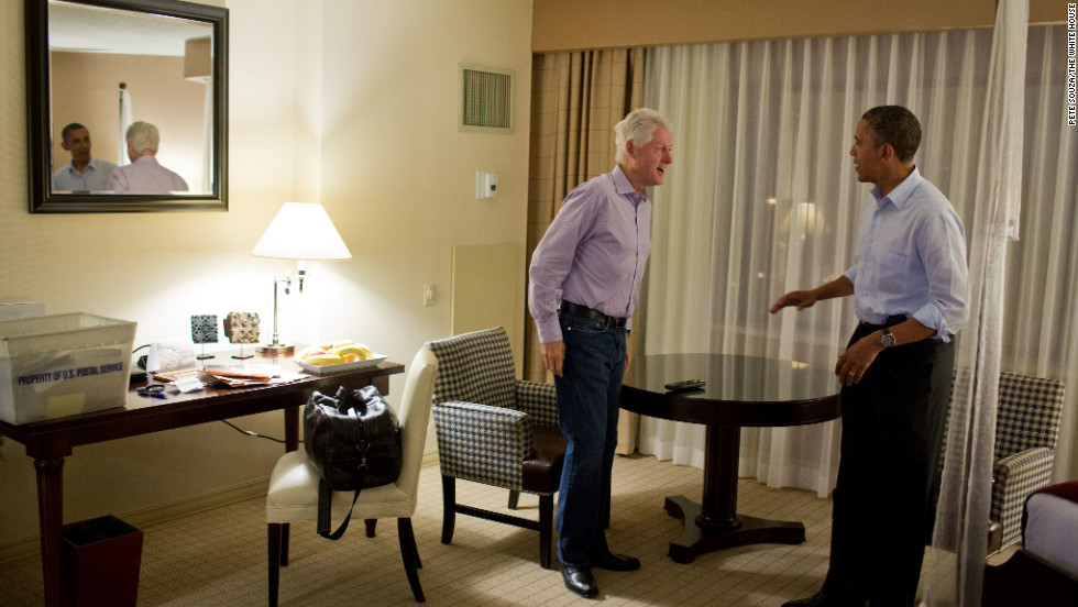 Obama talks with former President Bill Clinton at the DoubleTree Downtown Orlando Hotel in Orlando, Florida, on Oct. 28, 2012.