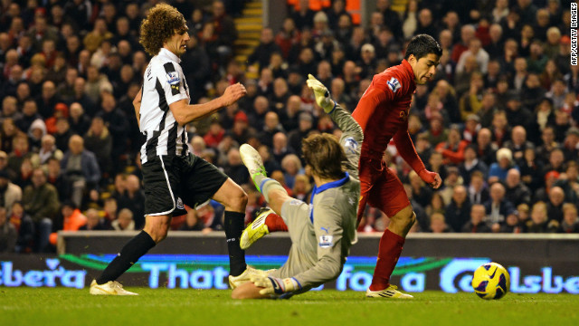 Liverpool striker Luis Suarez scores the equalizer against Newcastle after evading Fabricio Coloccini and goalkeeper Tim Krul.