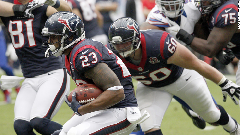 Texans running back Arian Foster rushes against the Bills on Sunday.