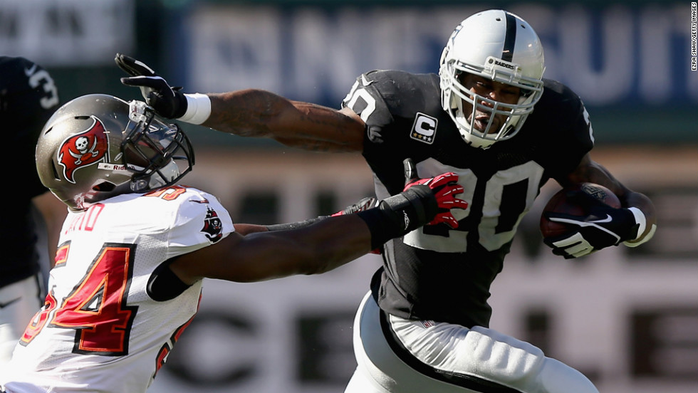 Oakland Raiders running back Darren McFadden gets away from Lavonte David of the Tampa Bay Buccaneers on Sunday at O.co Coliseum  in Oakland, California.