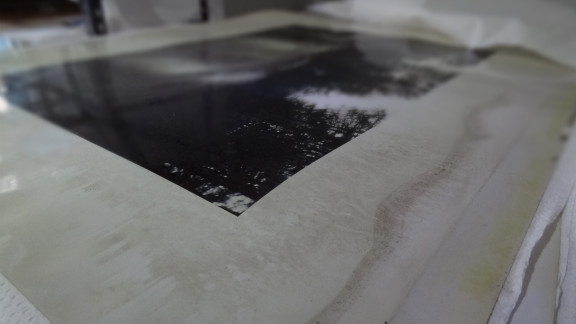 A photograph dries at Derek Eller Gallery after being damaged by Sandy flooding.