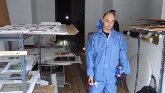 Owner Derek Eller stands in his gallery during cleanup efforts after the storm.