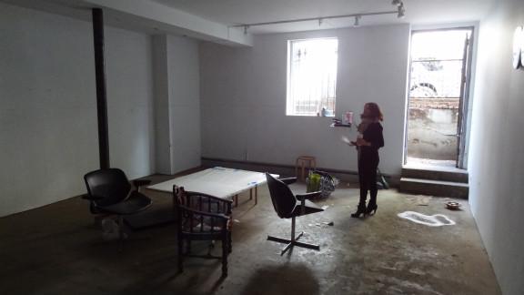 Marisa Newman assesses the flood damage at the Newman Popiashvili Gallery.