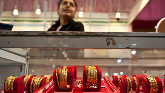 Indian women buy gold jewelry on Dhanteras -- the first day of the five-day festival -- in the belief it will bring them good fortune.