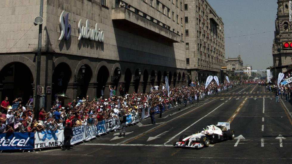 Seen here driving in an exhibition through the streets of his home city Guadalajara, Perez was already winning kart races by the age of six.