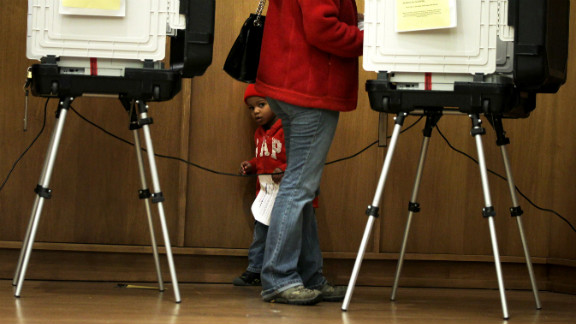 Two-year-old Ariel Ferreras accompanies his mother, Erika, as she votes in Silver Spring, Maryland, on Friday, November 2. Voters in Maryland broke the state