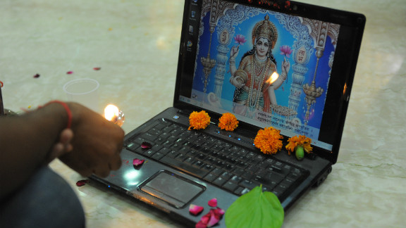 """Diwali marks the start of the new Hindu financial year. During this time many businesses open new account books and on the third day of the festival business people in some states worship their account books and work laptops. This ritual is called  """"Chopda Pujan"""", and blesssings are sought from Hindu deities Lakshmi and Ganesha."""