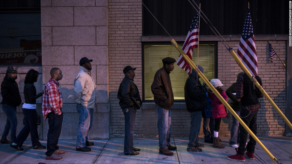 Voters line up at the Mount Pleasant Library early Tuesday in Cleveland, Ohio.