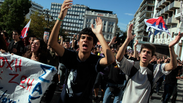 Demonstrators shout slogans Tuesday in front of the Greek parliament in Athens.