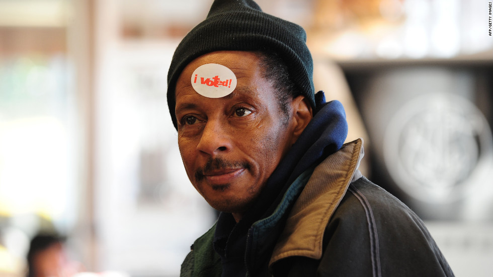 "Derrick Banks wears an ""I Voted"" sticker on his forehead after casting his ballot in Chicago."