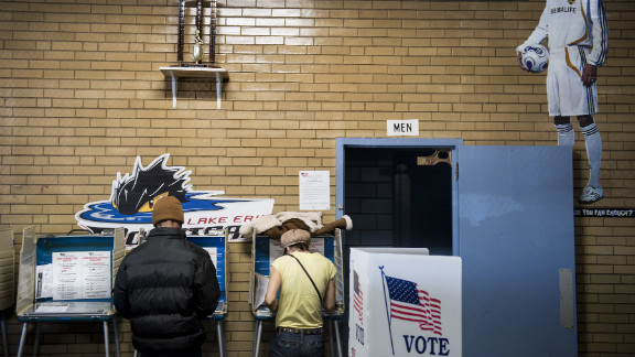 Voters mark paper ballots at Halloran Skating Rink in Cleveland, Ohio.