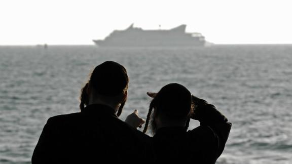 (File photo) Orthodox Jews look at Mavi Marmara off the Israeli coast on May 31, 2010 after it was raided by Israeli navy.