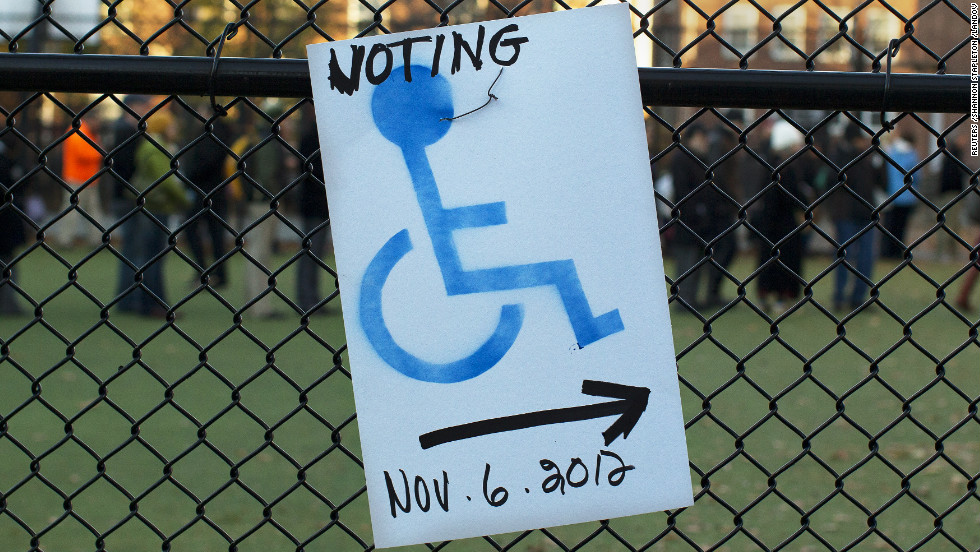 A sign directs disabled voters to a polling site entrance at the Graham & Parks School in Cambridge, Massachusetts.