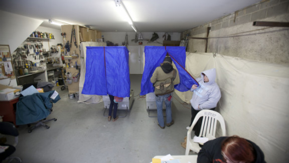 People cast their ballots inside a decorator
