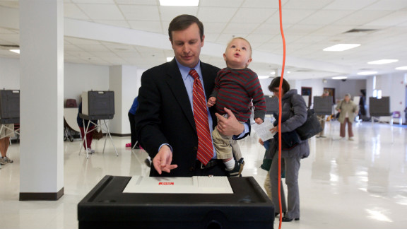 Three-term Democratic congressman and U.S. Senate candidate Chris Murphy casts his vote with his 1-year-old son Rider at Cheshire High School in Cheshire, Connecticut.
