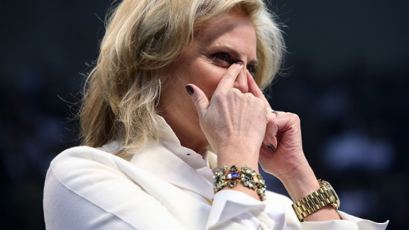 Ann Romney wipes away tears during her husband