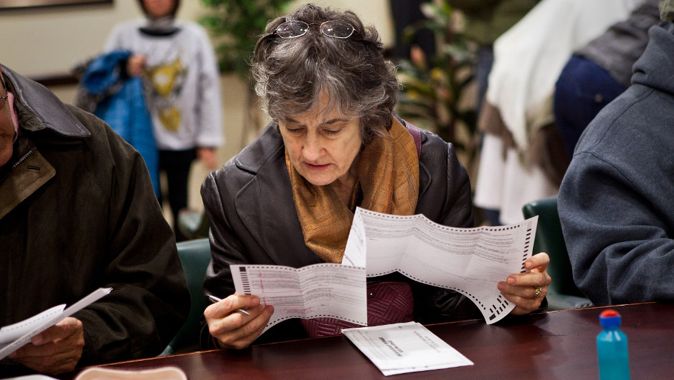 A woman fills out an early voting ballot on Sunday, November 4, in Jersey City, New Jersey. Gov. Chris Christie ordered early voting stations to stay open through the weekend in an effort to get people to vote despite the damage done by Superstorm Sandy.