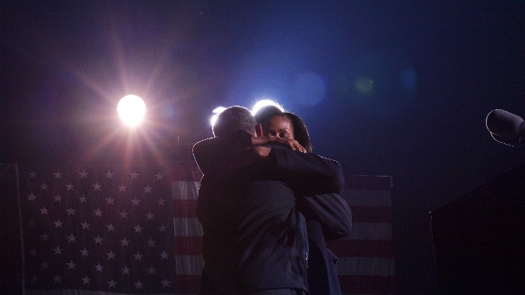 The president and first lady Michelle Obama embrace Monday in Des Moines at his last campaign rally before the election.