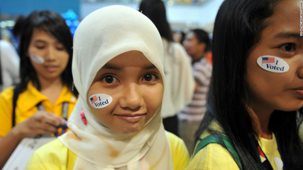 Philippine students in Manila decorate their faces with election stickers during a mock vote spearheaded by the U.S. Embassy on Wednesday.