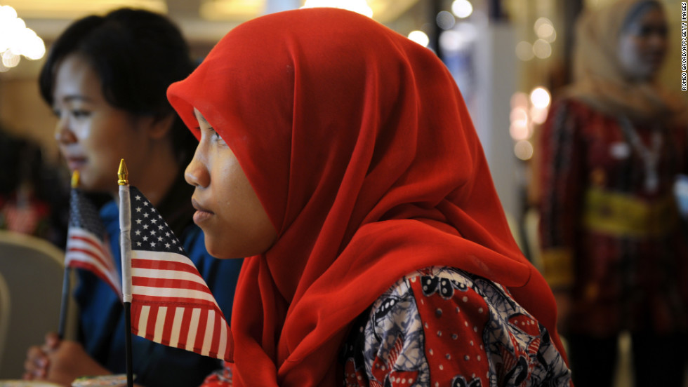 Indonesian student Anisa Widya Lestari, 20, holds a U.S. flag while watching election returns at a poll monitoring center set up by the U.S. Embassy in Jakarta on Wednesday, November 7. President Barack Obama spent some of his early childhood in the Indonesian capital.