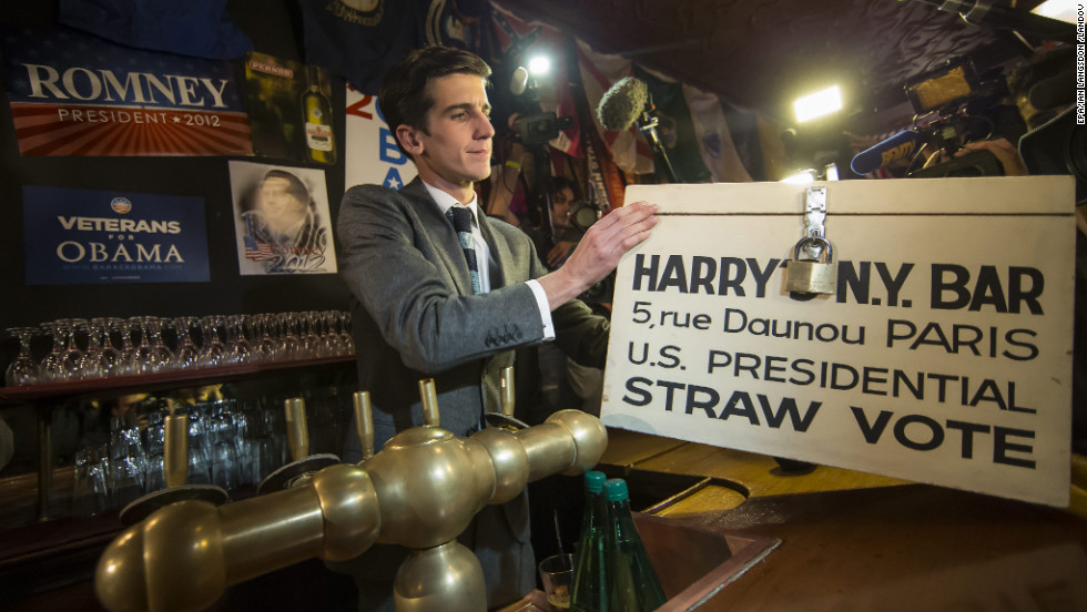 A staffer at Harry's New York Bar in Paris prepares to count mock ballots from a straw vote held Tuesday at the bar for U.S. expats.