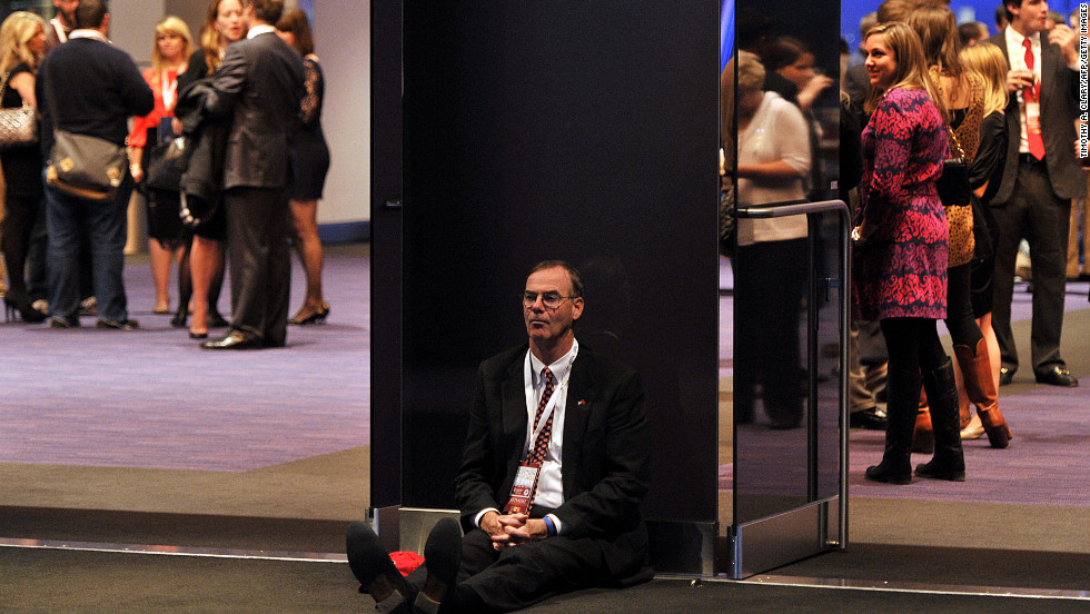 A dejected supporter of Republican candidate Mitt Romney slumped on the floor in Boston, Massachusetts.