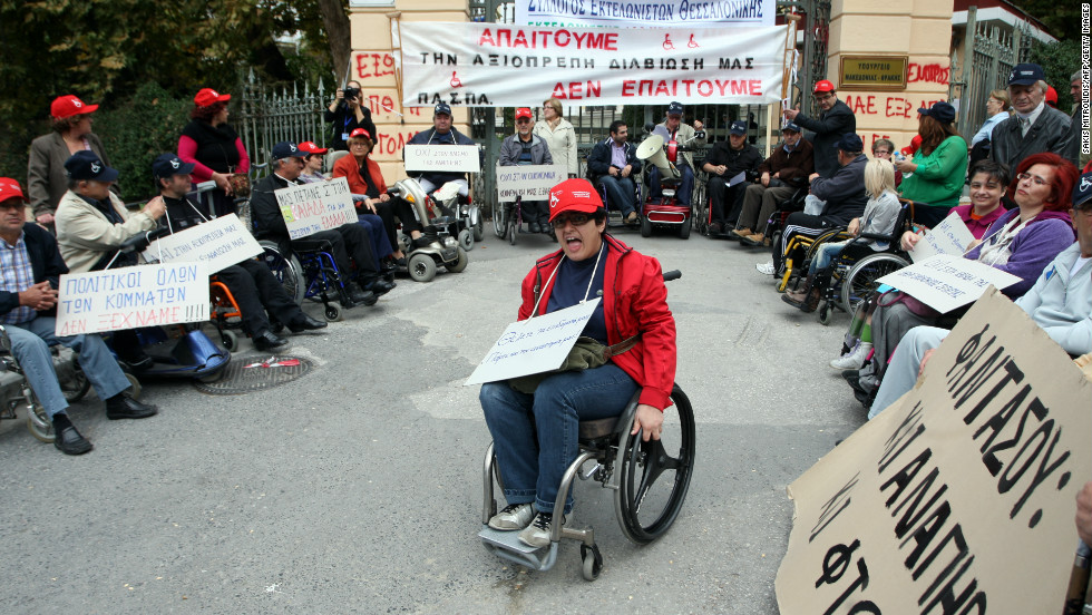 Wheelchair users protest against a new government austerity bill in Thessaloniki on 7 November, 2012.