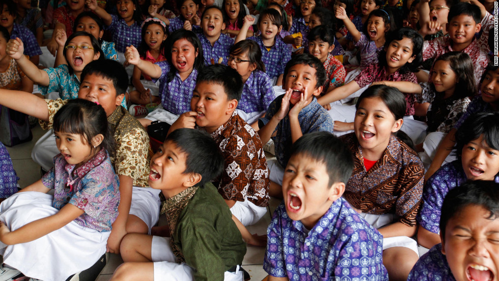 Students at the State Elementary School Menteng 01, where U.S. President Barack Obama studied from 1970-1971, cheer as they watch the U.S presidential election on television in Jakarta, Indonesia.