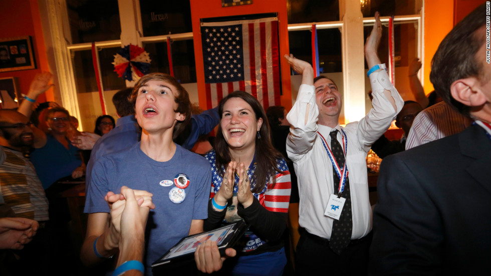 Obama supporters cheer during a U.S. election viewing party hosted by Democrats Abroad UK at the Sports Bar & Grill Marylebone in London, England.