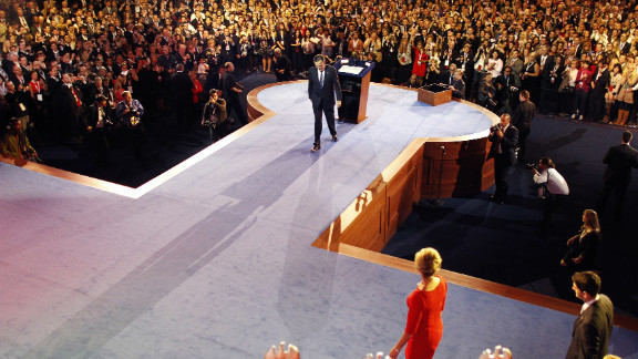 Mitt Romney slowly walked offstage in Boston after conceding the election to President Barack Obama.