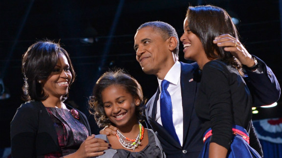 US President Barack Obama accompanied by (from L-R ) First Lady Michelle and daughters Sasha and Malia appears on stage on election night November 6, 2012 in Chicago, Illinois. President Barack Obama swept to re-election Tuesday, forging history again by transcending a slow economic recovery and the high unemployment which haunted his first term to beat Republican Mitt Romney. AFP PHOTO/Jewel Samad        (Photo credit should read JEWEL SAMAD/AFP/Getty Images)