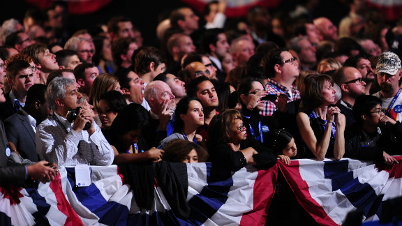 Obama supporters attentively watched televised election results at an election night event in Chicago.