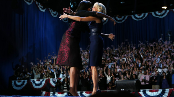 First lady Michelle Obama and Dr. Jill Biden hugged and will spend four more years in the public eye.