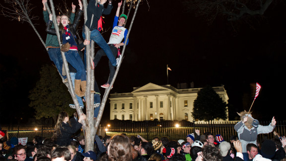 Children climbed trees outside the White House in Washington as people celebrated President Obama's victory at the polls.