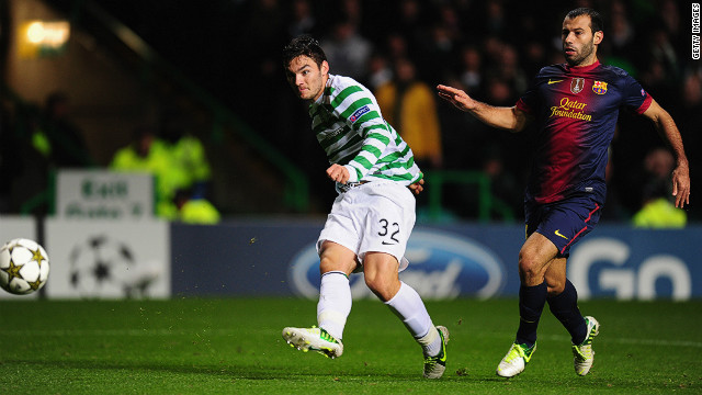 Teenage substitute Tony Watt scores Celtic's second goal as Barcelona's Javier Mascherano watches in Glasgow.