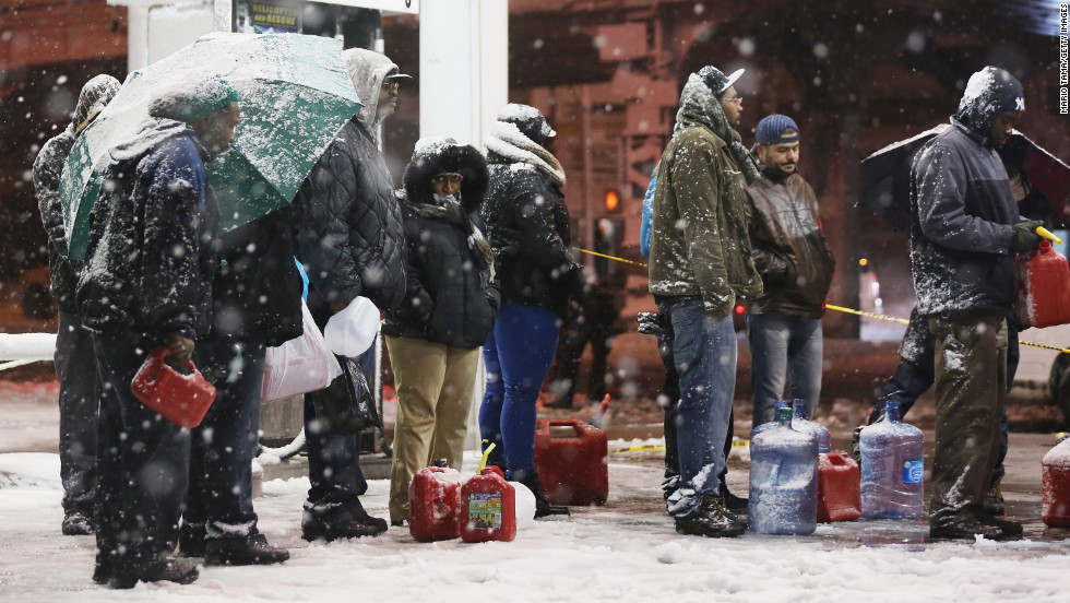 People wait in line to buy gasoline during the snowstorm on Wednesday night in  Brooklyn. The city is still short on gas because of Superstorm Sandy.