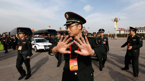 A soldier tries to prevent photos being taken in Tiananmen Square on November 7.
