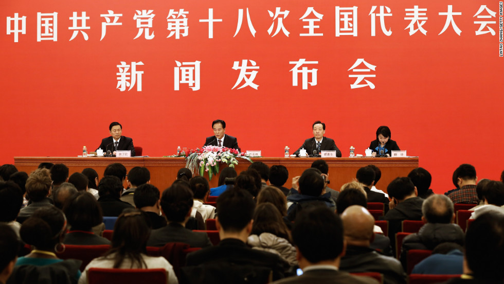 Congress spokesman Cai Mingzhao answers a question during a news conference at the Great Hall of the People.