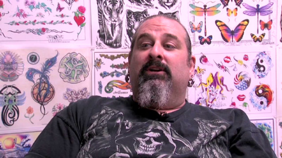 dng tattoo artist denied career day visit _00000904