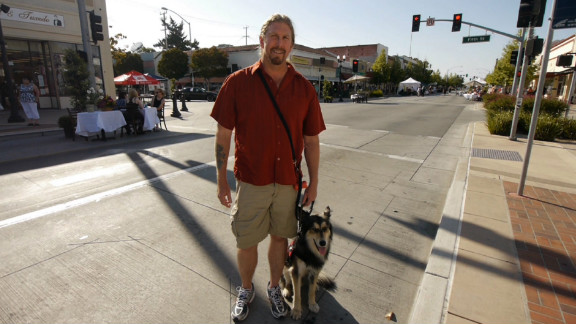 """Lobo helps Jeff Wilson keep cool in public places. Wilson doesn't like being startled, so with a simple """"watch my back"""" command, the border collie-German shepherd mix watches Wilson's 6 o'clock and gives him a little nudge if anyone walks up behind him at the grocery story or other public setting. If Wilson's anxiety kicks in, Lobo will jump and put his paws on Wilson's chest to give him something else to focus on."""