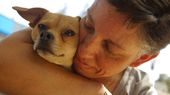 """Before she met Vito, Ana Sarver would average about two hours of sleep a night. Like many veterans with PTSD, she would struggle with restlessness, nightmares and hypervigilance. With Vito, """"as soon as he feels me restless, he wakes up and he wakes me up and brings me out of it. ... He keeps me from getting up in the middle of the night and pacing every which way."""" Vito also gives Sarver the ability to function during the day. With the dog at her side, Sarver feels more comfortable in social settings such as restaurants."""