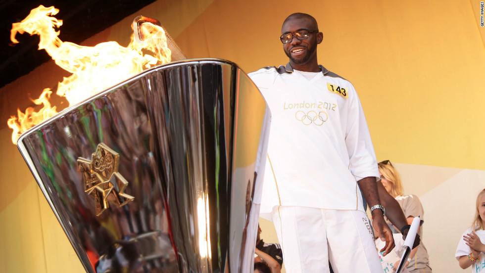 Muamba took part in the Olympic torch relay for the London 2012 Games. Here he lights the cauldron on day 64 of the flame's 8,000-mile journey around the UK.